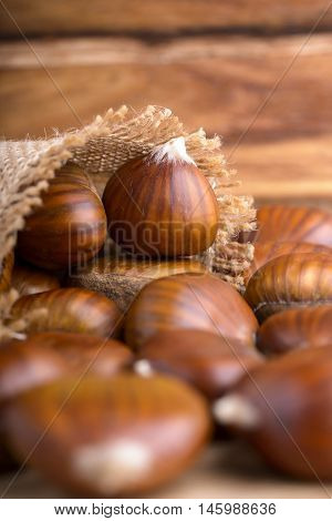 pile of chestnuts in a jute bag overturned