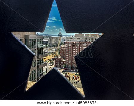Rooftop view of Capitol Hill through the star-shaped cut-out in a wall.