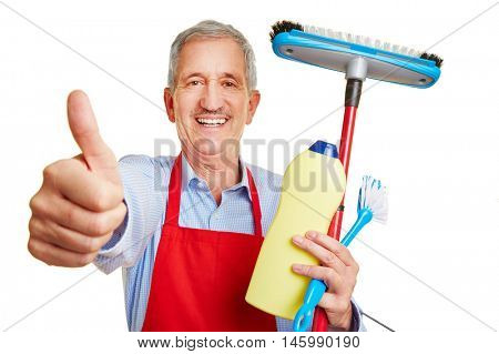 Happy housemaker with many cleaning supplies holding his thumbs up