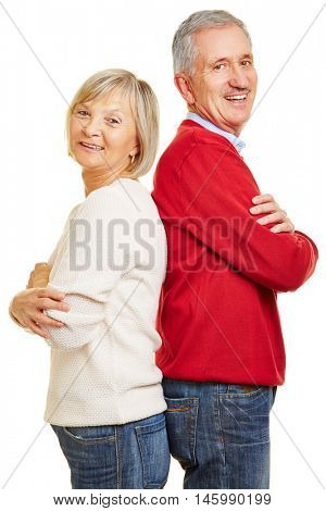 Happy senior couple leaning back to back with their arms crossed