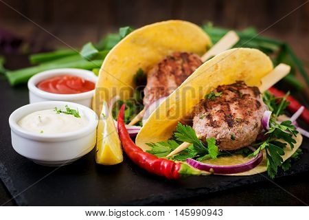 Tortillas Tacos With Appetizing Kebab (meatballs) And Sauce On Black Background