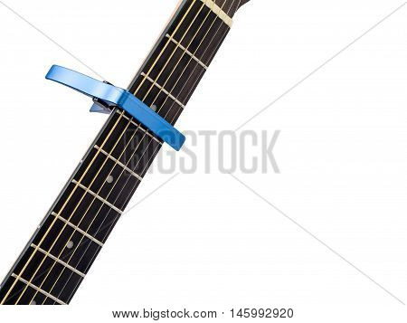 Blue capo on guitar fingerboard white background close up