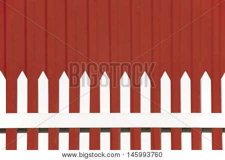 White wooden fence over a red background. Copy space. Horizontal