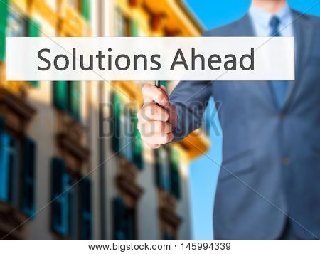 Solutions Ahead - Businessman Hand Holding Sign