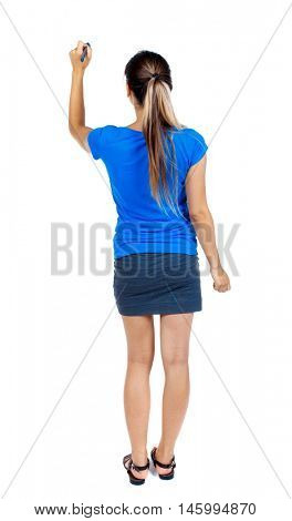 back view of writing beautiful woman. girl in a short skirt and a blue T-shirt draws felt-tip pen on the board.