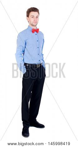 Smiling businessman in a bow tie looking up. top view. Proud businessman standing with his hands in his pockets.