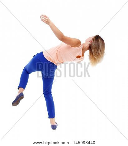 Balancing young woman. or dodge falling woman. Isolated over white background. The blonde in a pink t-shirt in freefall