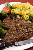 picture of porterhouse steak  - A mouth watering porterhouse steak with fresh vegetables and pasta - JPG