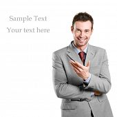 Happy businessman presenting and showing with copy space for your text isolated on white background
