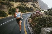 Fitness Woman Running On Countryside Highway poster