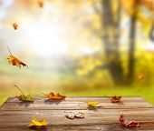 Colorful maple leaves on wooden  table.Falling leaves natural background .Autumn season concept poster