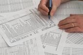 stock photo of income tax  - Internal Revenue Service tax forms for the filing of annual taxes - JPG