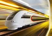 super streamlined train with motion blur moves in tunnel
