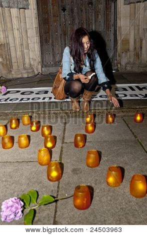 A Representative From The Exeter Hindu Temple And Community Lighting A Candle At The Peace Walk.