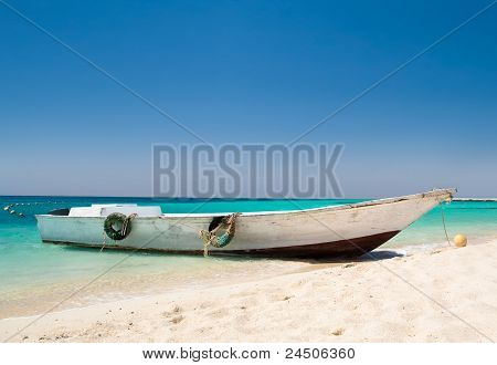 Idyllic seascape with a boat by the shore