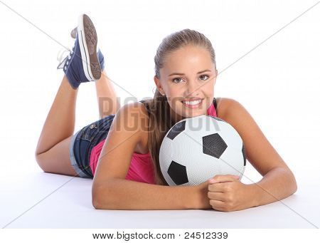 Beautiful Teenage Soccer Girl Lying On Floor