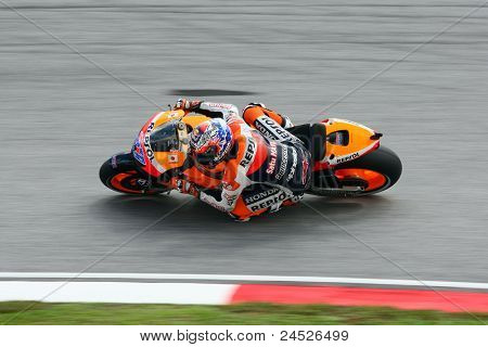 SEPANG, MALAYSIA - OCTOBER 21: MotoGP rider Casey Stoner tests his bike during the free practice session at the Shell Advance Malaysian Motorcycle GP 2011 on October 21, 2011 at Sepang, Malaysia.