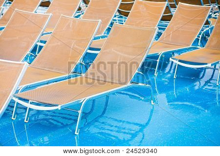 Textile Chairs On Wet Deck Of Cruise Liner