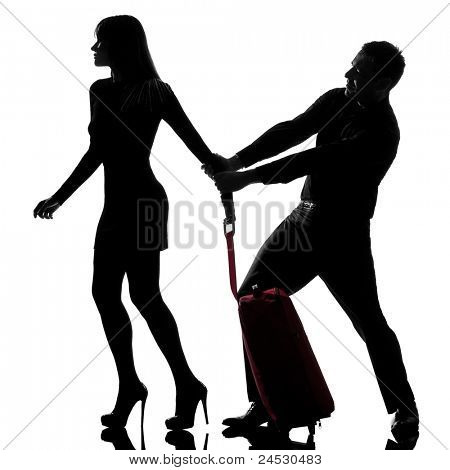 one caucasian couple dispute separation woman leaving and man holding back in studio silhouette isolated on white background