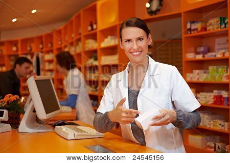 Pharmacist Pointing To Product