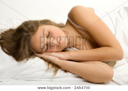 Young Girl Sleep In Bed