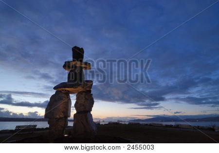 Inukshuk Sculpture At English Bay In Sunset
