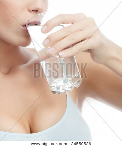 portrait of attractive  caucasian woman isolated on white studio shot drinking water