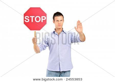 A man gesturing and holding a traffic sign stop isolated on white background