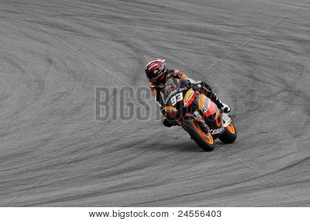 SEPANG, MALAYSIA - OCTOBER 22: Moto2 rider Marc marque competes at the qualifying session of the Shell Advance Malaysian Motorcycle GP 2011 on October 22, 2011 at Sepang, Malaysia.