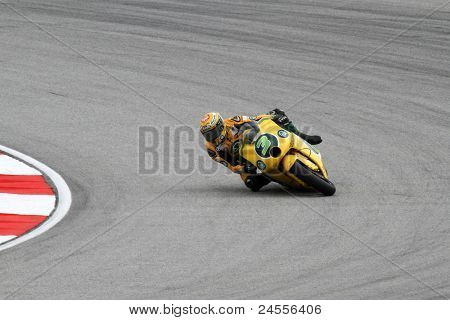 SEPANG, MALAYSIA - OCTOBER 22: Moto2 rider Simone Corsi competes at the qualifying session of the Shell Advance Malaysian Motorcycle GP 2011 on October 22, 2011 at Sepang, Malaysia.