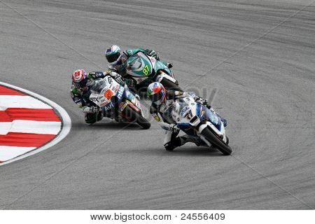 SEPANG, MALAYSIA - OCTOBER 22: Moto2 riders Kenny Noyes (9) and M Zamri (97) competes at the qualifying event of the Shell Advance Malaysian Motorcycle GP 2011 on October 22, 2011 at Sepang, Malaysia.