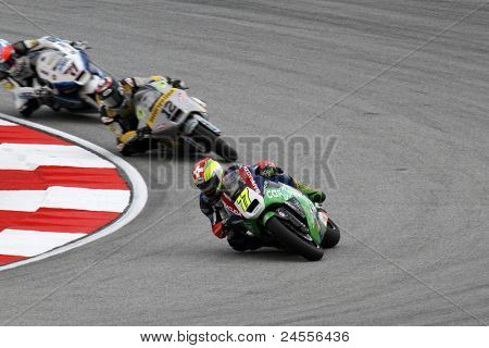 SEPANG, MALAYSIA - OCTOBER 22: Moto2 rider Dominique Aegerter (77) competes with other riders at the qualifying race of the Malaysian Motorcycle GP 2011 on October 22, 2011 at Sepang, Malaysia.
