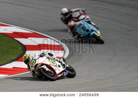 SEPANG, MALAYSIA - OCTOBER 22: Moto2 rider Michele Pirro (51) competes with other riders at qualifying race of the Shell Advance Malaysian Motorcycle GP 2011 on October 22, 2011 at Sepang, Malaysia.