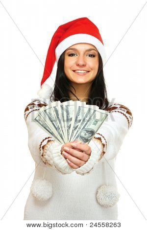 A Christmas girl with dollars in herr hands, isolated on white