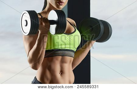 poster of Cropped Photo Of Strong Fit Model Training In Gym , Doing Fitness Lifting Exercises With Heavy Dumbb