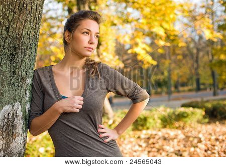 Beautiful Young Brunette In Autumn Park.