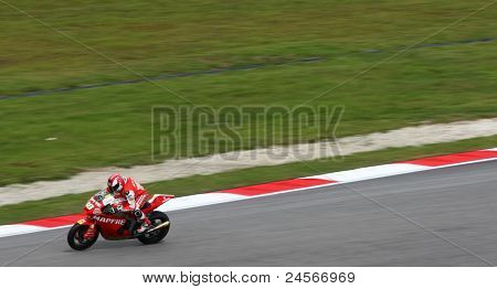 SEPANG, MALAYSIA - OCTOBER 22: Moto2 rider Jordi Torres sprints downhill after turn 2 at the qualifying race of the Shell Advance Malaysian Motorcycle GP 2011 on October 22, 2011 at Sepang, Malaysia.