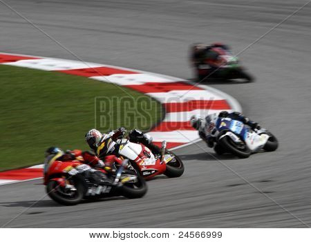 SEPANG - OCTOBER 22: Moto2 rider Santiago Hernandez (64) races with other riders at the qualifying race of the Shell Advance Malaysian Motorcycle GP 2011 on October 22, 2011 at Sepang, Malaysia.