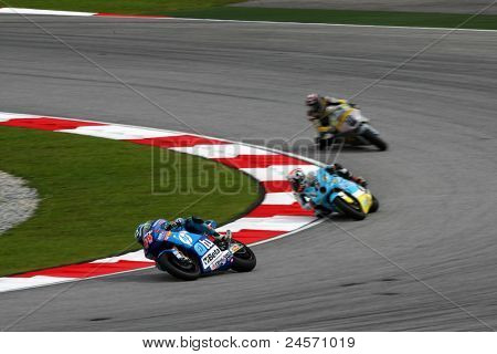 SEPANG, MALAYSIA - OCTOBER 22: Moto2 rider Pol Espargaro (44) leads other riders at the qualifying race of the Shell Advance Malaysian Motorcycle GP 2011 on October 22, 2011 at Sepang, Malaysia.