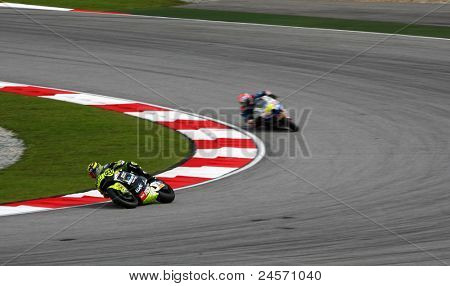 SEPANG, MALAYSIA - OCTOBER 22: Moto2 rider Andrea Iannone (29) competes at the qualifying race of the Shell Advance Malaysian Motorcycle Grand Prix 2011 on October 22, 2011 at Sepang, Malaysia.
