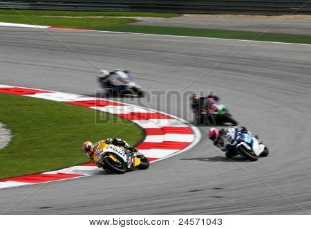 SEPANG, MALAYSIA- OCTOBER 22: Moto2 rider Alex de Angelis (15) races with other riders at the qualifying race of the Shell Advance Malaysian Motorcycle GP 2011 on October 22, 2011 at Sepang, Malaysia.