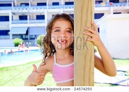 indented kid girl ok gesture in pool garden holding sunroof pole