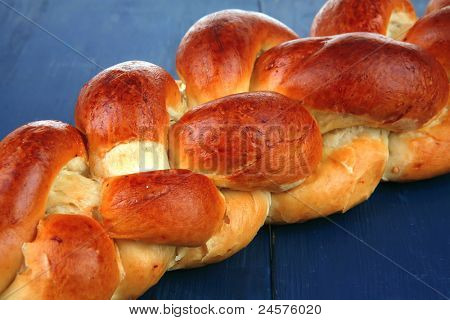 sweet bread : golden challah over blue wooden plate