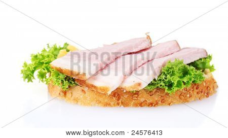 tasty sandwich with vegetables and ham isolated on white