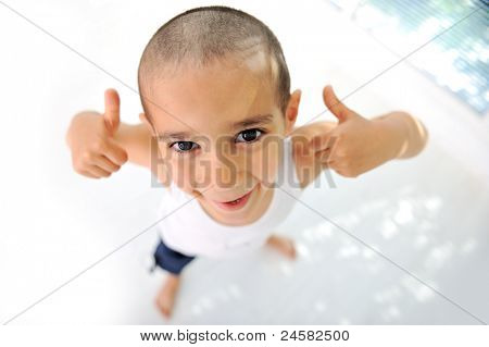 Thumbs up! Little boy, cute short hair, almost bald :)