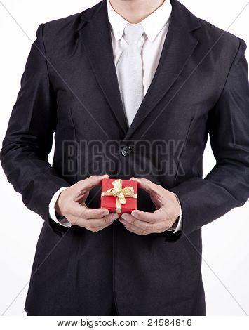 Unrecognized Businessman Holding Birthday Gift