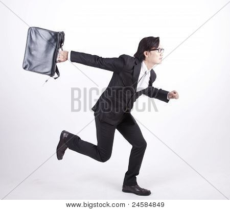 Asian Businessman Running Isolated On White
