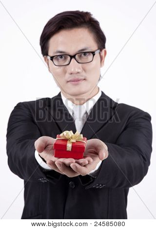 Handsome Asian Businessman With Gift