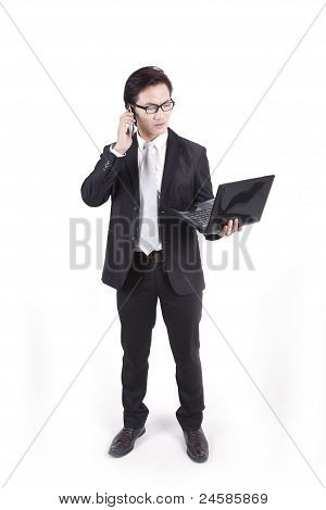Businessman With Laptop And Mobile Phone