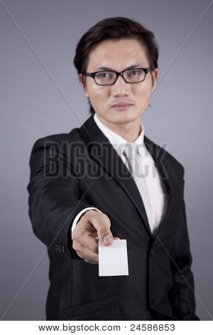 Asian Businessman Offering An Empty Business Card